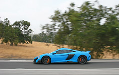 675LT (sumosloths) Tags: mclaren 675lt 675 lt longtail long tail blue light turquoise orange accents brake calipers roof scoop body color freeway highway driving moving tracking panning motion side view profile trees monterey car week carmel pebble beach menlo park palo alto los altos hillsborough sand hill road rd 280 california bay area san francisco norcal northern grass brown spotted spotting 2016 sumosloths 650s mp412c 12c