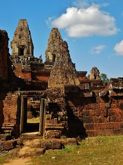 doorway to Pre Rup (SM Tham) Tags: asia cambodia angkor prerup khmer stone temple architecture pyramid towers doorways sky clouds outdoors steps people statues unescoworldheritagesite