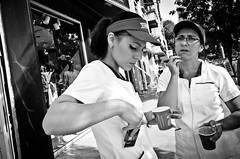 Must Be Break Time (stimpsonjake) Tags: nikoncoolpixa 185mm streetphotography bucharest romania city candid blackandwhite bw monochrome cigarettes coffee break women