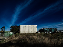 144 (Steve Taylor (Photography)) Tags: 144 toilet container wasteland building blue green contrast stark concrete newzealand nz southisland canterbury christchurch cbd city autumn cloud sky sunshine sunny wall blank
