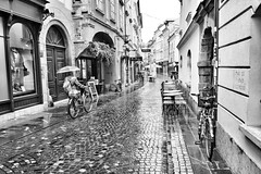 (Tom Plevnik) Tags: bnw blackandwhite candid city flickr human ljubljana monochrome nikon outdoor public people places photography rain road street streetphotography urban architecture