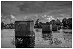 Traces from the past (hervemarcilloux) Tags: falkenberg halland sweden bridge old water river tran landscape black white monochrome sony a77