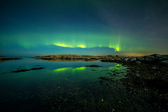 Aurora Reflections (Arvid Bjrkqvist) Tags: aurora northernlight green reflections mirror water sea ocean sky night stars moonlight sweden gothenburg lilleby torslanda clouds samyang14mmf28