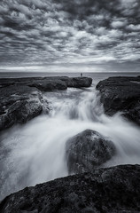A Man Apart (Crouchy69) Tags: sunrise dawn landscape seascape ocean sea water coast rocks clouds sky black white mono devils cauldron whale beach sydney australia