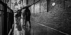 Undercover (Sean Batten) Tags: london england unitedkingdom gb rain blackfriars city urban ricoh gr blackandwhite bw pavement umbrella commuters people bridge