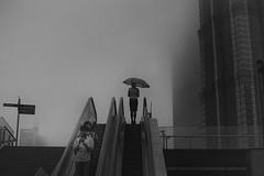 communal isolation~ Shanghai (~mimo~) Tags: china street people blackandwhite woman man rain umbrella photography asia shanghai grain mobilephone mimokhair communalisolation