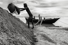 Just another day of a journeyman... (_MaK_) Tags: lifestyle people bw monochrome dailylife river boat sand transport worker story bangladesh