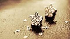 Stars (Zsofia Nagy) Tags: stars macromondays macro earrings silver sepia csillag golden