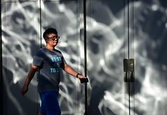 stride of a new idea... (Maggie's World ...) Tags: reflectiononwall shanghai light shadow youngman strideofanewidea springinitssteps
