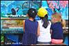 Let's Play Together - Richmond Maritime Festival N18013e (Harris Hui (in search of light)) Tags: harrishui nikond300 nikonuser nikon d300 vancouver richmond bc canada vancouverdslrshooter nikon85mmf18 piano streetpiano kids child letsplaytogether candid portrait streetcandid candidportrait britanniashipyard steveston