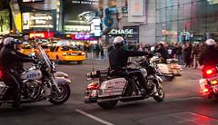 Street Patrol (Ash and Debris) Tags: night usa cops street city bike evening traffic urbanlife police urban road patrol motion moving cop timessquare bikes illumination clitylife newyork nyc