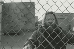 Guard Dog (SSelJEFE) Tags: angry scary dog shop fence beard hairy mean cage film canon photograhpy bw scream yell teeth growl snarl animal