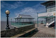 Clevedon pier#1 (Hugh Stanton) Tags: lamp light bench shelter telescope stairs