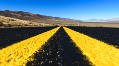 Yellow lines (Zoltan Acs) Tags: outdoor road roadtrip nevada desert abandoned tarmac black surface lines traffic yellow bluesky endless far away escape flat rocky curve take drive cars travel valley