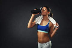 Attractive young woman drinking proteins (tension_magazine) Tags: protein nutrition woman fitness drink sports young beautiful shake girl female body muscular drinking sexy slim white bodybuilding beauty people adult attractive pretty healthy supplements athlete strong caucasian dark background towel wear studio 20s serbia