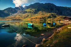 4 on a rope (Chrisnaton) Tags: melchseefrutt switzerland mountains mountainlake boats lakereflection lakeshore bluesky alpine nature
