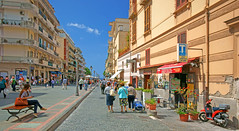 Maiori, Amalfi Coast, Province of Salerno, Campania, Italia, Italy (Minoltakid) Tags: maiori amalficoast provinceofsalerno campania italia italy ladysitting lady people relaxing fun walking sitting moped scooter street via buildings shops old town day flickr streetscene photograph photo view outside it theminoltakid minoltakid rossdevans rossevans