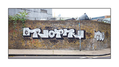 Graffiti (Rope), East London, England. (Joseph O'Malley64) Tags: rope graffiti streetart urbanart eastlondon eastend london england uk britain british greatbritain wall walls brickwork pointing concrete granitekerbing tarmac single doubleyellowlines junction yard workskops buddleia lamppost sugns signage barbedwire securityspikes accesscover urban urbanlandscape aerosol cans spray paint