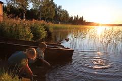 Play (BL259) Tags: light boy sunset summer lake girl reeds golden evening boat play sweden dusk norrbotten