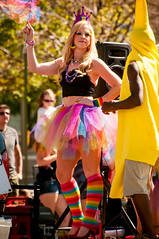 girl dancing with a banana (Sam Scholes) Tags: woman man guy girl festival digital fun utah costume rainbow nikon colorful banana parade event saltlakecity blonde tutu d300 tutuskirt utahpridefestival2013 utahprideparade2013