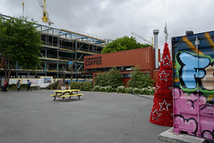 Coffee Time (Jocey K) Tags: newzealand christchurch shippingcontainers mural artwork streetart buildings cranes shops people christmastrees christmasthings stars colour clouds sky trees restartmall cafe rebuild table