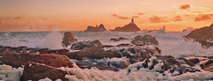 High Winds (theofficialwilson) Tags: wind water sea foam rocks sunset sunrise landscape seascape clouds waves red orange blue yellow coast coastline lighthouse