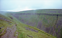 approaching high cup nick (Ron Layters) Tags: path sheep highcupnick cliffs valley pennineway whinsill dolerite ushapedvalley glaciation basaltintrusion slope scree basalt micklefell badweather moorland narrowgatebeaconhills murtonfell landscape day7 england unitedkingdom slidefilmthenscanned slide transparency fujichrome velvia canoneos300v canon eos300v rebelti ronlayters