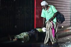 Your Fellow Human Being (N A Y E E M) Tags: oldman homeless vagabond umbrella latenight eve eid eidalfitr rain monsoon street viptower chittagong bangladesh availablelight windshield