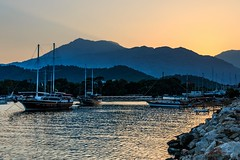 A time to rest (Anthony Plancherel) Tags: boat category kemer kemerbay landscape places seascape sunset time transport travel turkey canon canon70d travelphotography boats tourboats bay mountains sunrays orange sunglow goldenhour goldenlight waves outdoor landscapephotography rocks evening
