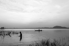 Morning Rituals |  | Kolavai Lake,Chennai. (vjisin) Tags: cwc chennai weekend clickers kolavai lake chengalpattu nikond3200 nikonofficial nikon cwc530   sky outdoor serene skyline water monochrome blackandwhite nature minimalism boatman composition treeshade mountain tree plant sunse