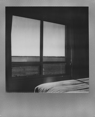 Room with a view (The Stugots) Tags: sx70 sx 70 impossible project film black white bnw bw silver frame instant roidweek polaroid week polaroidweek lake view bay front water erie presque isle expired photography snapitseeit sail boat boats pennsylvania