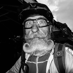Street Portrait #033 (Never Edit) Tags: street photography streetphotography outdoor outside people peopleinthestreet strada day gloomy city urban expression close candid portrait dark mysterious strange look alone blackandwhite monochrome humour humor realstreetphotography purestreetphotography light shadow focus beard glasses