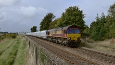 66115 slows down to a crawl as it reaches it's destination, with the Montsorrel - Kennett Redland Stone Train and 22 x HOA Hoppers in tow. 12 10 2016 (pnb511) Tags: class66 kennett redland sidings ipswichtocambridgeline burybranch lafarge aggregates stone train trains railway diesel loco locomotive traffic dbcargo dbc