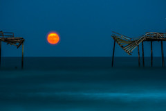 Full Sturgeon Moon Rising (Xavier Ascanio) Tags: frisco nc pier moon full sturgeon atlanticocean hatteras island moody rainy ruin water dusk twilight surreal peaceful tranquil mood landscape landmark