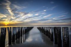 DSC2516 (ste.wi) Tags: water groynes sunset sun clouds beach breakwaters horizon