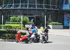 Gathering (Roving I) Tags: vespas motorscooters gathering friends helmets sunprotection facemasks discussions steps entrances vincomcentre vietnam malls danang