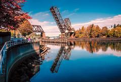 Ballard Locks Early Autumn (Doug Knisely) Tags: trees olympus ballardlocks bridge ballard water omdem5markii autumn sky 1517 sunny fall seattle railroad