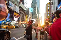 Manhattanhenge Pose (UrbanphotoZ) Tags: manhattanhenge woman posing 42st timessquare regal modells ninelives empire amc25theaters spectators photographer dusk sunset westside manhattan newyorkcity newyork nyc ny