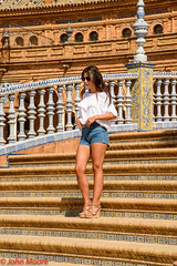 Girl on Steps (2) (Juanito Moore ( John Moore )) Tags: sevilla spain espaa crdoba girl sun shine blue sky buildings medieval lagiralda catedral cathedral river guadalquivir architecture pretty stunning shorts reflections flowers shadows people chinese frog animals colour photo foto photographer fotgrafia