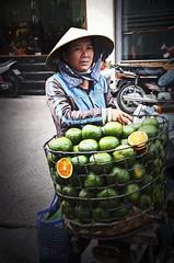 King Oranges (Artypixall) Tags: vietnam saigon hochiminhcity streetvendor kingoranges motorcycles urbanscene faa