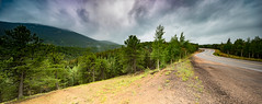 Stormy Mood at Pike's Peak (photosbydmitriy) Tags: shiftpanorama landscape canyon pikespeak moody canon clouds ominous hillside treeline road tse17 trees dark motorcycles colorado sky green fineartphotography wet pavement mountain woodlandpark unitedstates us