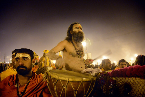 Naga sadhu with drums, riding a horse - Maha Kumbh Mela
