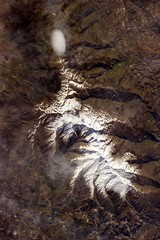 Lenticular Cloud from Orbit (sjrankin) Tags: lake snow mountains clouds edited nasa lenticularcloud lenticular oval iss snowcap iss035 18may2013 iss035e39236 ovalcloud