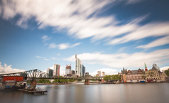 (mainone) Tags: city longexposure bridge cloud colour water skyline architecture clouds race skyscraper canon river photography eos photo long exposure day ship frankfurt main picture fast 7d nd frankfurtammain ffm maintower nd110 mainone canoneos7d christiangehrig