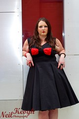 IMG_4503 (Neil Canon Keogh) Tags: red black vintage necklace highheels dress retro ring redhead bow buskers bracelet heels rockband pinup pinupgirl trianglesquare manchestercitycenter dressmodellaura