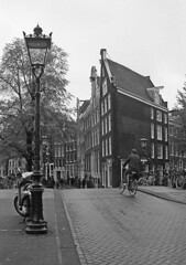 Cyclist (Keith Marshall) Tags: road film amsterdam bicycle canon buildings eos cyclist 100 300 agfa rodinal apx selfdeveloped adox aph09 adolux 15013min