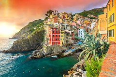 Riomaggiore village on the Cinque Terre coast of Italy,Europe (talyho88) Tags: ocean old city travel blue sea summer vacation cactus urban italy panorama orange house mountain building tourism beach nature water rock architecture landscape island lights evening bay harbor town colorful europe mediterranean riviera cityscape view liguria landmark lagoon medieval historic resort journey terre destination coastline vernazza manarola cinque attraction riomaggiore
