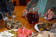 Cretan feast with fasting (Eleanna Kounoupa) Tags:     greece crete rethymnon akoumia      snails wine stuffed olives appetizers  hands