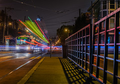 the 22 and passing muni tram (pbo31) Tags: sanfrancisco california nikon d810 color september 2016 summer boury pbo31 bayarea night dark lightstream motion roadway motionblur muni churchstreet platform bus missiondistrict castrodistrict infinity black gate depthoffield