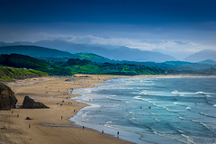 Oyambre Beach (Jose L. Parra) Tags: beach cantabria cantabricsea clouds espaa europa green landscape oyambre parquesnacionales picosdeeuropa sea waves bath bather blue lowtide mountains northofspain pasture people rocks sly summer surf trees water